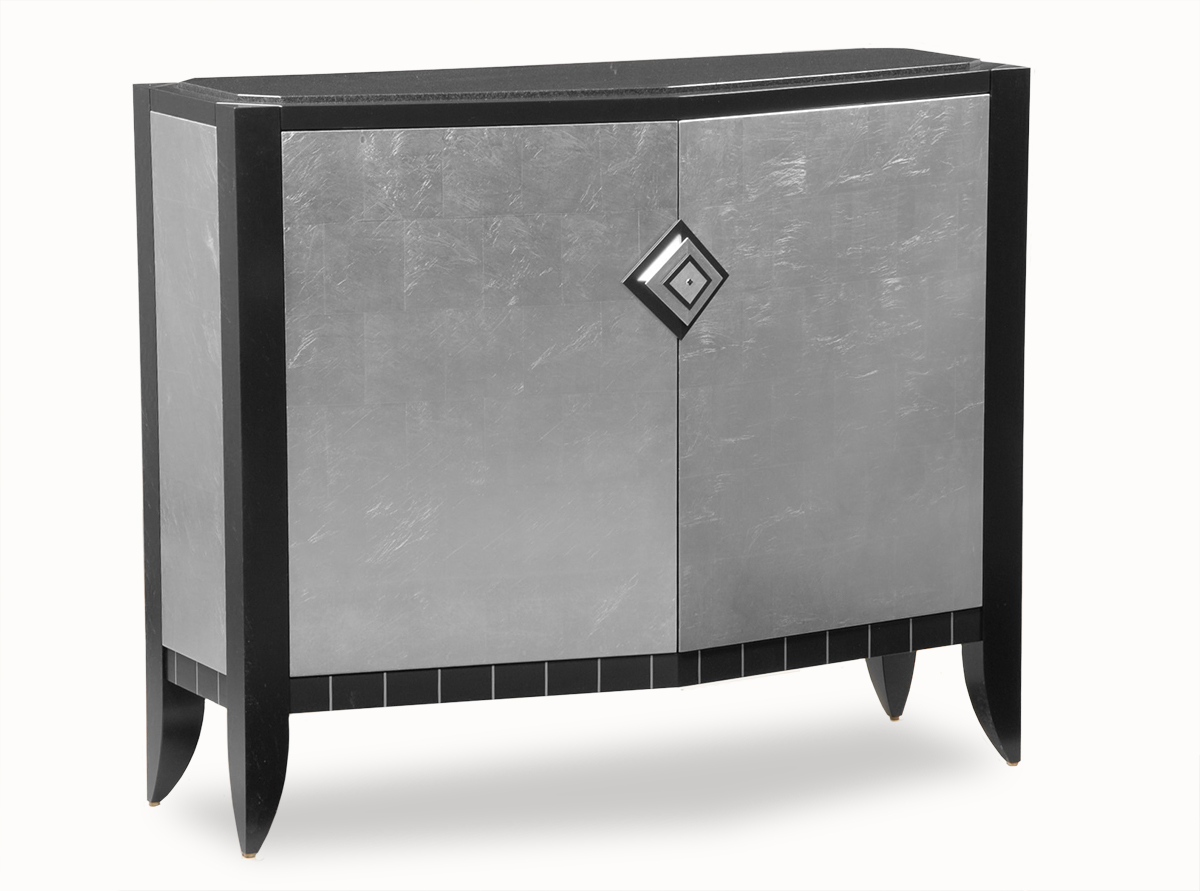 This Version Features Silver Leaf Facade, With Jet Black Legs And Black  Granite Top. Doors Open To Reveal Drawers.
